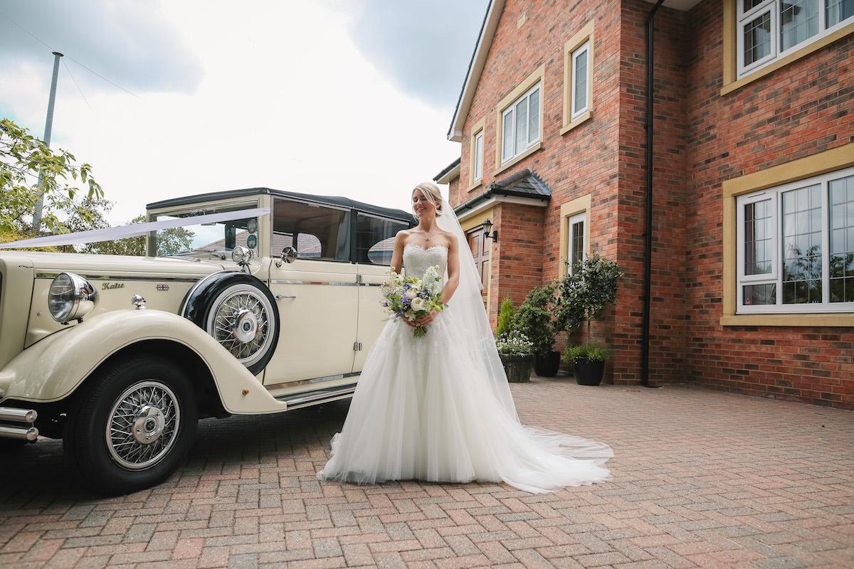bride with vintage wedding car