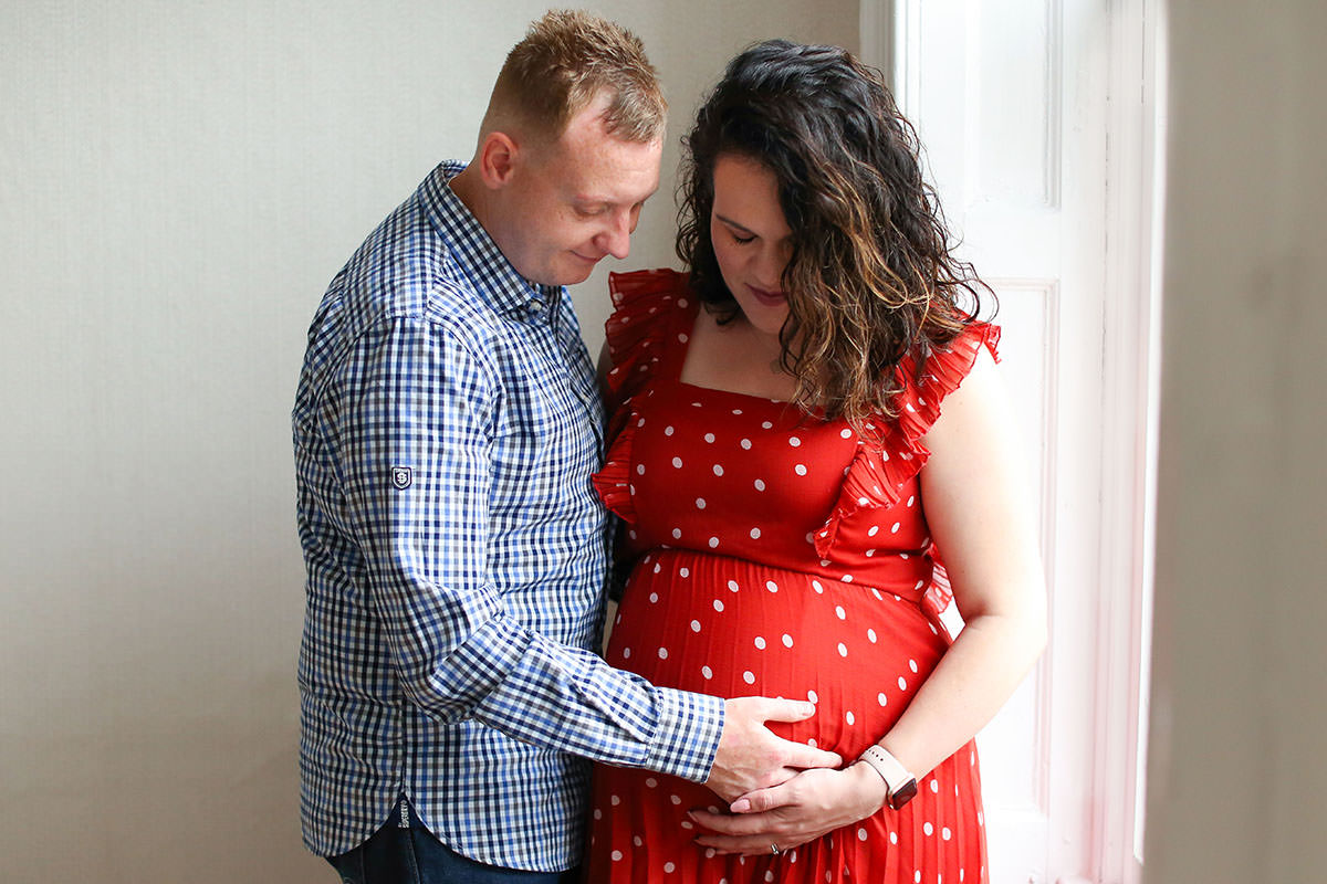 red dress couple maternity portraits
